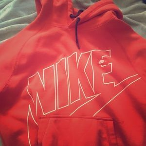 Nike red hoodie not with a rip on it
